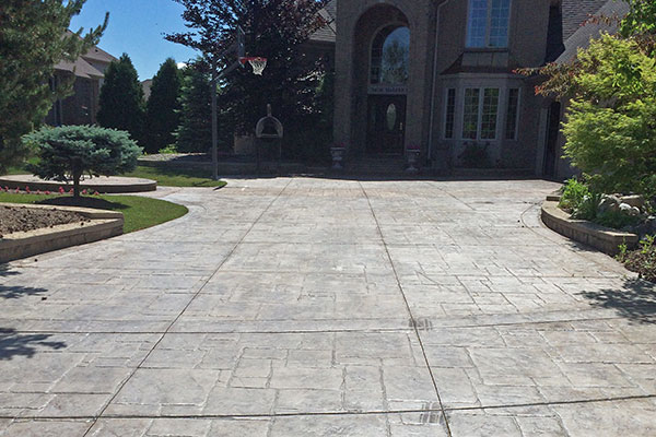 how to seal stamped concrete driveway before