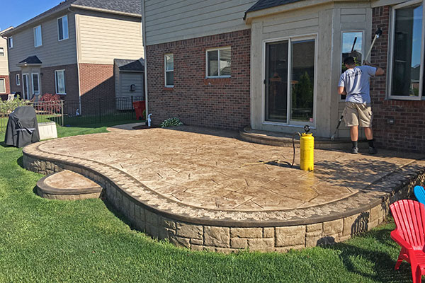 how to seal stamped concrete patio before