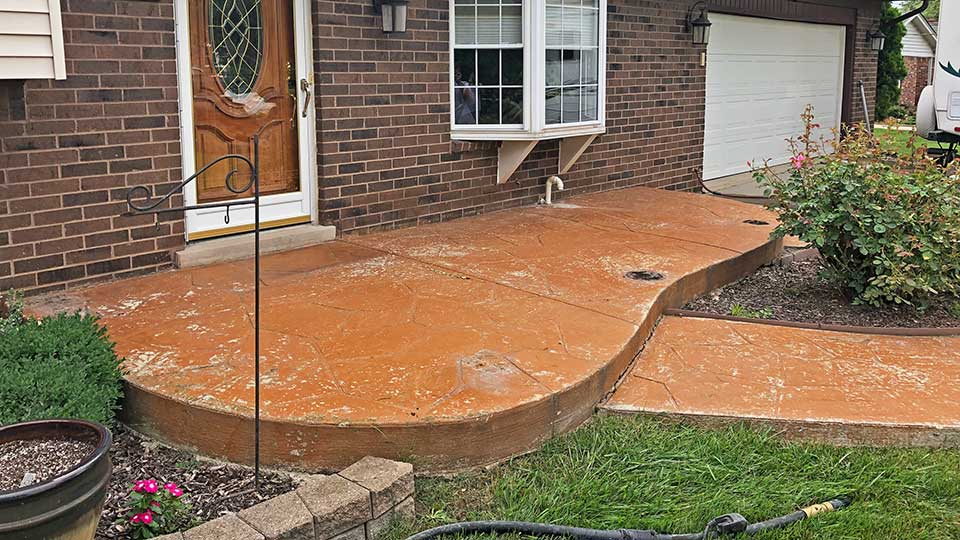 stamped concrete front patio before concrete sealer stripping in macomb and oakland county, MI