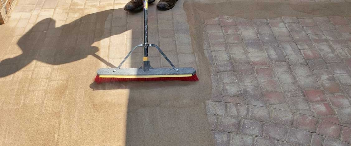 poly sanding brick paver court yard